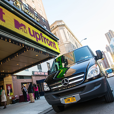 A luxury van parked outside of the MTV Upfront presentation.