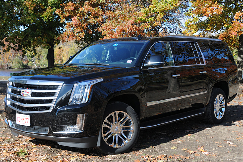 A Cadillac ESV luxury SUV, used by Commonwealth Worldwide for chauffeured black car services.