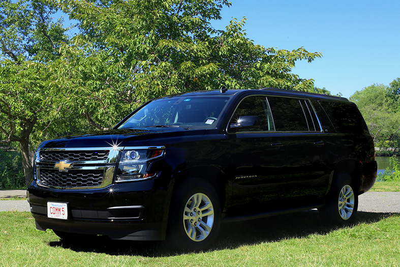 A Chevrolet Suburban luxury SUV, used by Commonwealth Worldwide for chauffeured black car services.