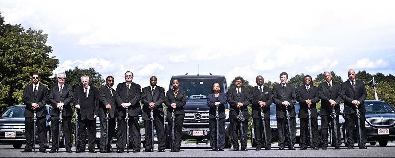 Commonwealth Worldwide chauffeurs posing for a group photo.