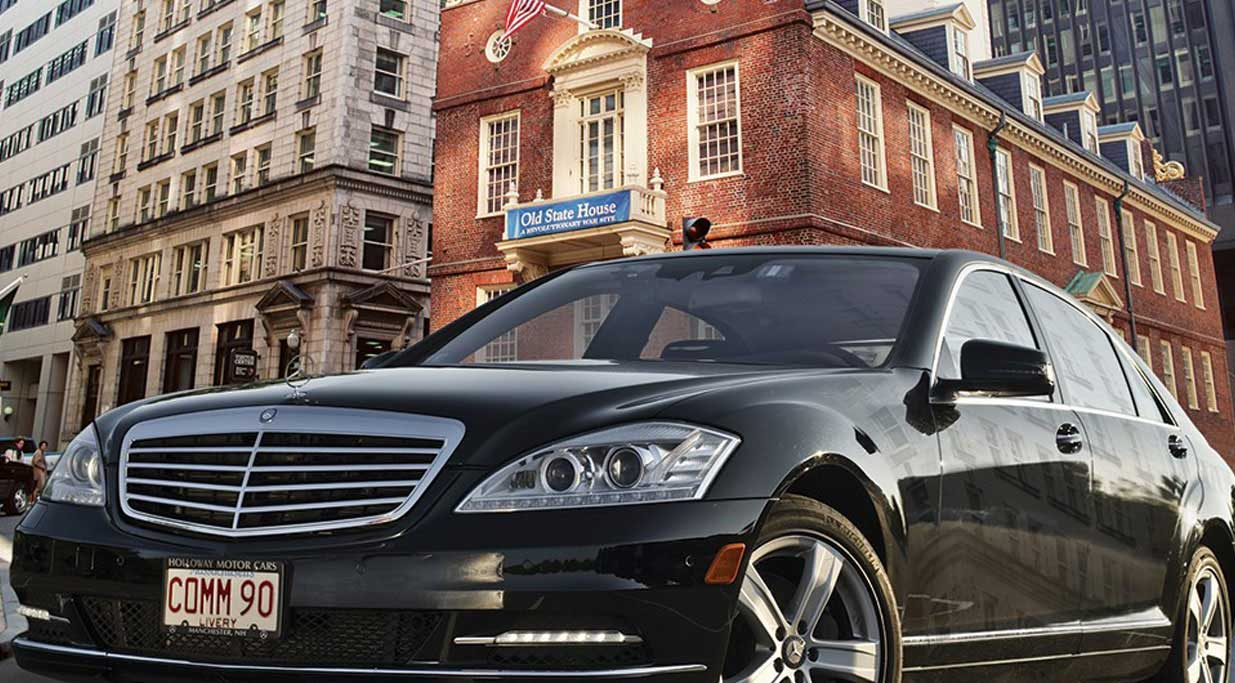 A luxury sedan from Commonwealth Worldwide's fleet, parked outside the Old State House in their home city of Boston.