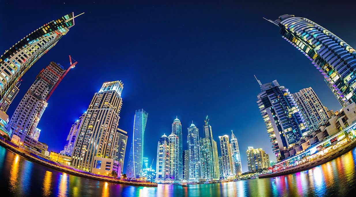 The Dubai, skyline photographed at night.