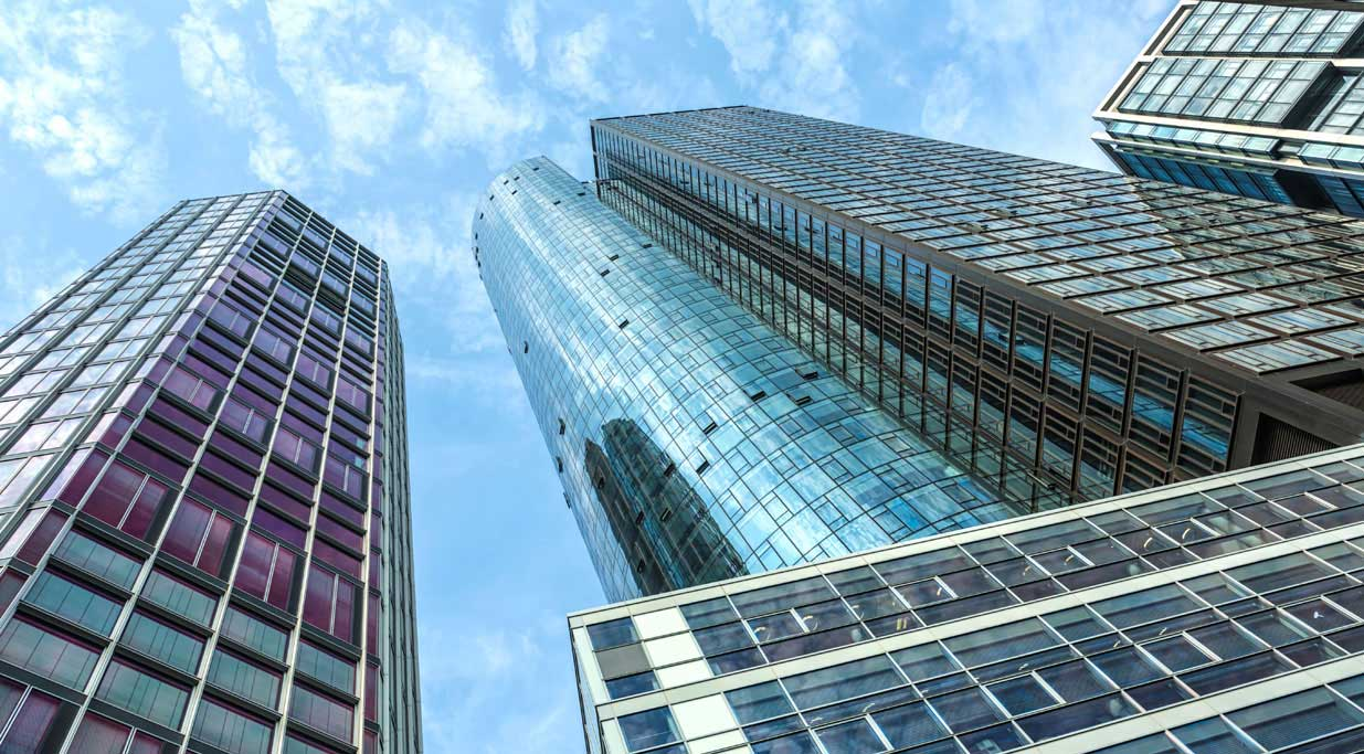 A low-angle camera shot of an office tower in Frankfurt, Germany.